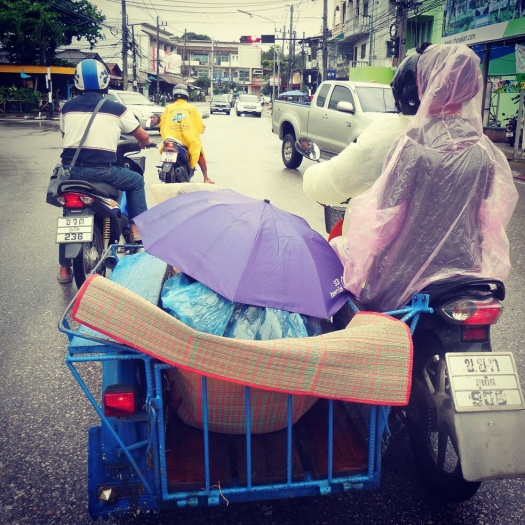 There are three adult women and a baby int hat sidecar and guaranteed a couple bags of raw fish....snuggle up!